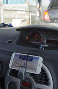 Phone use as a navigation system in automobile - stock photo