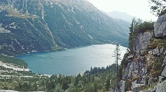 Hiker woman standing on the edge of the cliff. Stabilized, 4K Ultra HD. Stock Footage