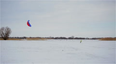 Kiter goes for a drive on snow-covered field in winter Stock Footage