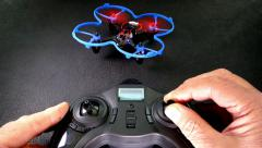 Quadcopter taking off indoors. Stock Footage