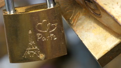 A padlock with a carved of Eiffel tower and Paris Stock Footage