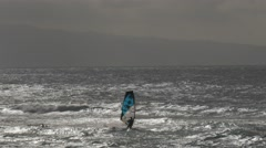 Backlit windsurfer Stock Footage