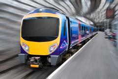Modern Passenger Commuter Transport Train with Motion Blur Stock Photos