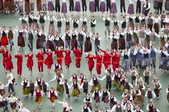 RIGA, LATVIA - JULY 11, 2015: Dancers in traditional costumes perform at the - stock photo