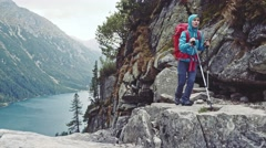 Hiker woman hiking with backpack in high mountains, epic view. Stabilized 4K. Stock Footage