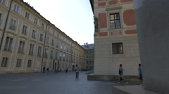 Tourists walking in Hrad III. nádvoří in the Prague Castle Complex Stock Footage