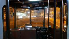 Traditional tramway interior, loudly drive through night city Stock Footage