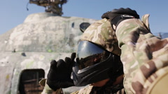 A man wears a helmet for paintball Stock Footage