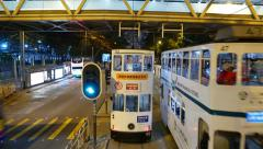 Double decker tram traffic at night city, POV view from second level deck Stock Footage