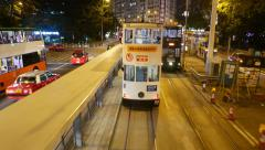 Approaching tram riding ahead, night city road, close up view interior Stock Footage
