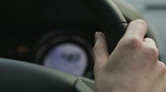 Female Hand on a Steering Wheel Stock Footage