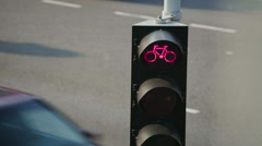 Cyclist Stop Light with City Traffic Stock Footage