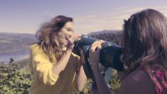 Woman Uses Coin Operated Telescope, Her Friend Pops In Front To Surprise Her Stock Footage