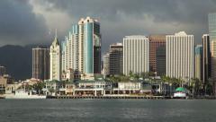Honolulu Harbor and Downtown Honolulu near sunset (pan) Stock Footage