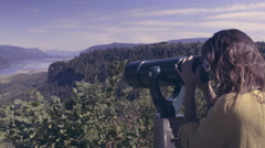 Woman Uses Coin Operated Telescope At Overlook In The Columbia River Gorge Stock Footage