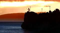 Sunset Black Rock Cliff Dive Ceremony at the Sheraton Maui Resort. Stock Footage