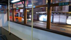 Tram interior, night city sweep outside, modern megalopolis. Stock Footage
