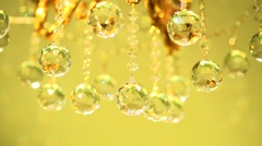 Crystal shines in the sunlight. Gold chandelier with crystal balls. Stock Footage