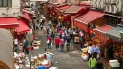 Citizens walk through street market, lively traditional marketplace TIME LAPSE Stock Footage