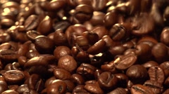 Coffee beans fall. Slow motion. Stock Footage