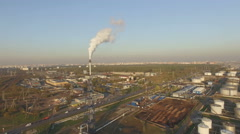 Stock Video Footage of View of large oil refinery chimney.