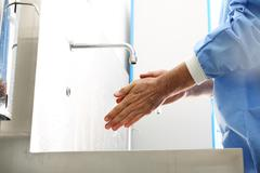 Surgical hand disinfection. Stock Photos