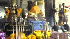 Close-up golden Buddha statues and smoking of joss stick burning, slow motion - stock footage