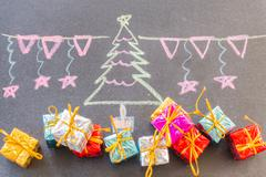 Stock Photo of Hand drawn Xmas design with chalk on blackboard
