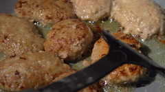 Cutlets are fried in oil. Slow motion. Stock Footage