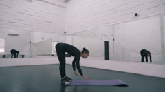 Young  woman doing sport exercises in fitness hall, wide angle Stock Footage