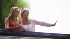 Attractive smiling mother & daughter spending time together outdoors - stock footage