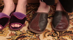 Slippers on the carpet. - stock footage
