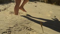 Woman feet in the sand Stock Footage