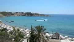View of the beach Coral Bay in Cyprus with different activities, time lapse Stock Footage