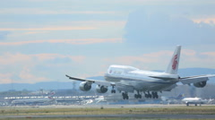 Air China Boeing 747 landing at 25L Stock Footage