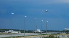 Lufthansa Airbus 340 approaching on runway 25R Stock Footage