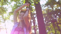 young, beautiful woman enjoying the fresh air in the forest - stock footage