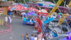 Children's carousel in an amusement park. Stock Footage