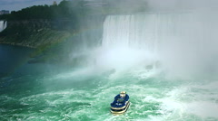 Niagara Falls Boat that Tickets can be bought to be able to see the falls from Stock Footage