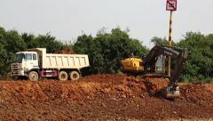Excavator operation near riverbank of Tonle Sap lake in Cambodia Stock Footage