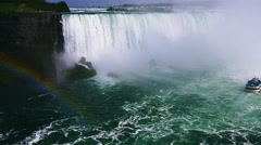 Niagara Falls Boat that Tickets can be bought to be able to see the falls from - stock footage
