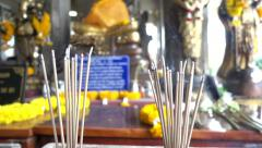 Close-up golden Buddha statues and smoking of joss stick burning, slow motion Stock Footage