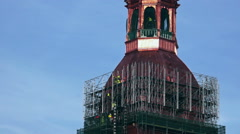 Restorers working on a 13th-century church tower restoration. Stock Footage