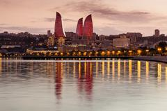 View of the waterfront and the city at night, in Baku, Azerbaijan. - stock photo