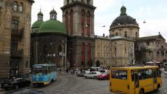 Road traffic near the Dormition or Assumption church in Lviv, Western Ukraine Stock Footage