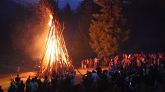 People near the bonfire celebrate the feast of Ivan Kupala Day Stock Footage