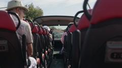 Tourist on opentop sightseeing bus on tour Stock Footage