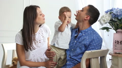 Stock Video Footage of parents blow to the kid and cheer him