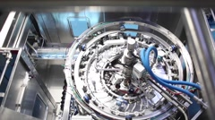 Production line, machinery in a factory moving bottles on conveyor - stock footage