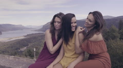 3 Friends Sit Together At Scenic Overlook, They Laugh And Talk (4K) Stock Footage